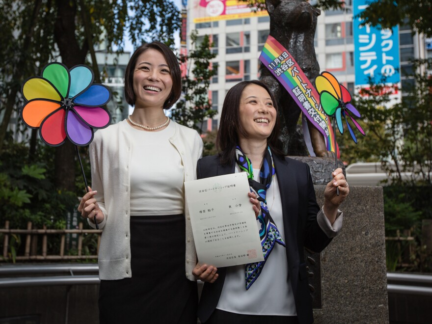 In this 2015 photo, Koyuki Higashi (left) and Hiroko Masuhara celebrate and hold up their same-sex marriage certificate in Tokyo. Today 13 gay couples filed a lawsuit arguing the country's general rejection of same-sex marriage rights violates the constitution.