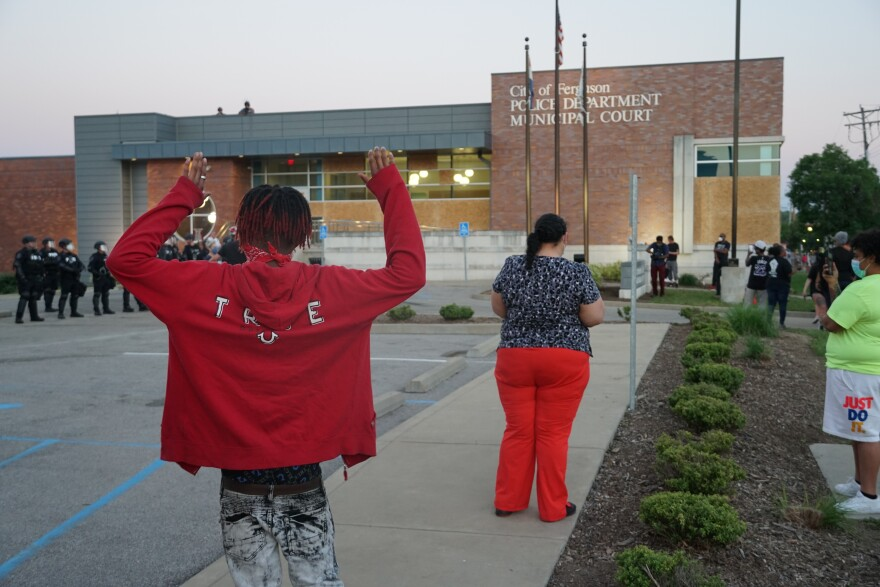Protesters broke several windows of the Ferguson Police Department building was vandalized on Saturday. 05/31/20