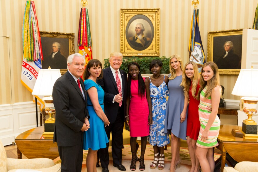 """President Donald Trump and his daughter Ivanka flank Chibok schoolgirls (left to right) Joy Bishara and Lydia Pogu. At far left is Doug Wead, president of the school the girls attend, and his wife, Myriam. Two of his daughters are at the right. This White House """"Photo of the Day"""" was taken on June 27."""