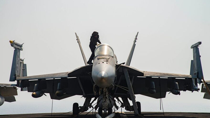 An F/A-18E Super Hornet is pictured in July on the flight deck of the aircraft carrier USS Dwight D. Eisenhower, which is deployed in support of Operation Inherent Resolve, which is targeting ISIS in Iraq and Syria.
