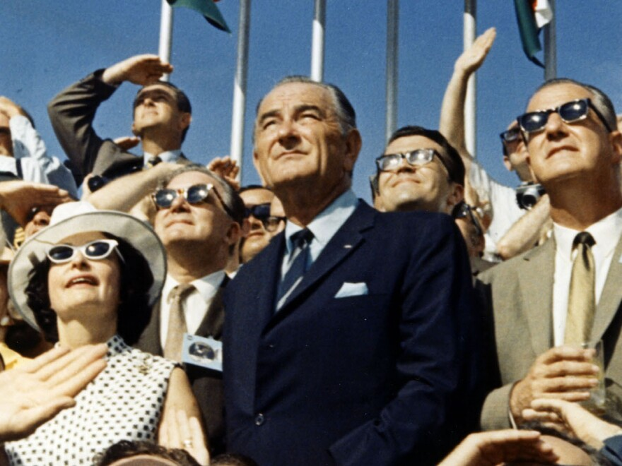 Vice President Spiro Agnew (right) and former President Lyndon Johnson view the liftoff of Apollo 11 from the stands at the Kennedy Space Center on July 16, 1969.