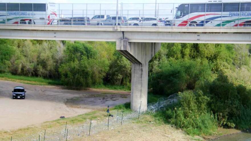 Concertina wire runs along the riverbank under the Hidalgo-Reynosa International Bridge.