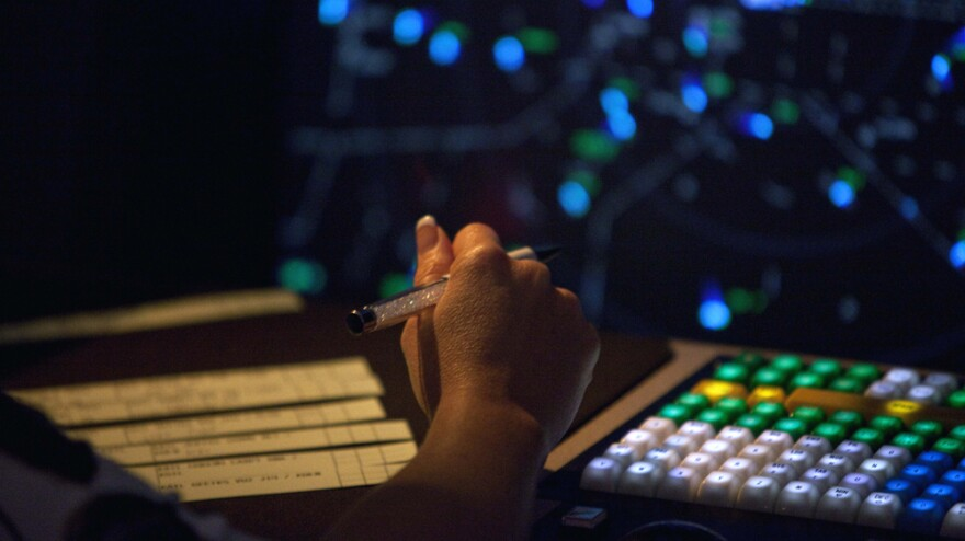 An air traffic controller works at the Atlanta TRACON, or terminal radar approach control, facility in Peachtree City, Ga. The FAA's NextGen program will modernize the air traffic control system, transforming it from radar to GPS-based technology.