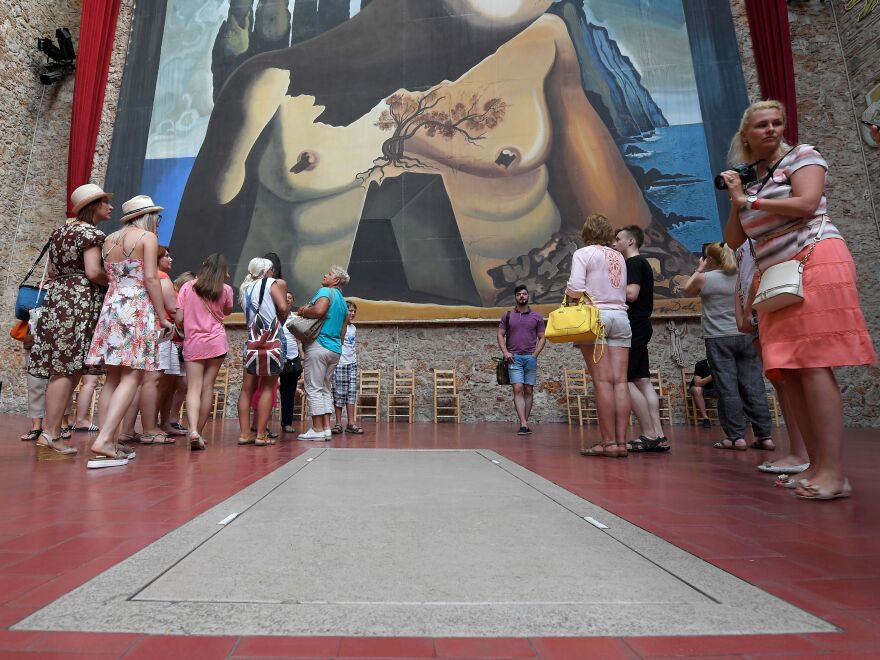Tourists visit Salvador Dali's tomb at the Dali Museum Theater in Figueres on Friday, following the exhumation of his remains.