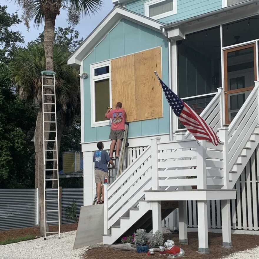 Neal Estroff and a friend board up his house on Tuesday in Tybee Island, Georgia, in anticipation of Hurricane Dorian.