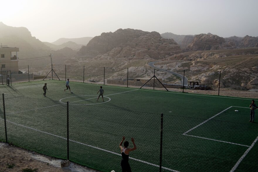 Boys play soccer on a field in the Bedouin village of Um Sayhoun, near Petra.