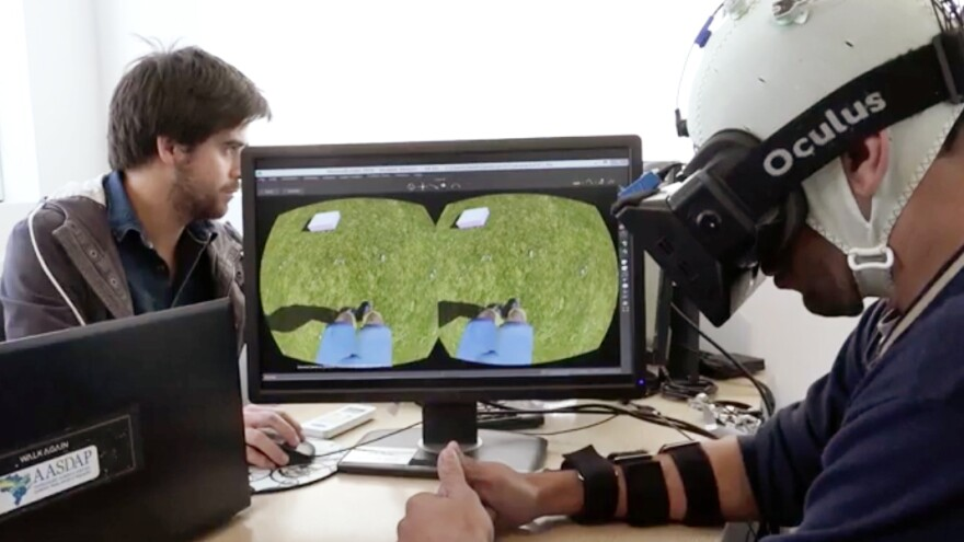 Part of the training in Miguel Nicolelis' research involves having a patient with spinal cord damage learn to use an avatar to walk in virtual reality, while being given visual and tactile feedback.