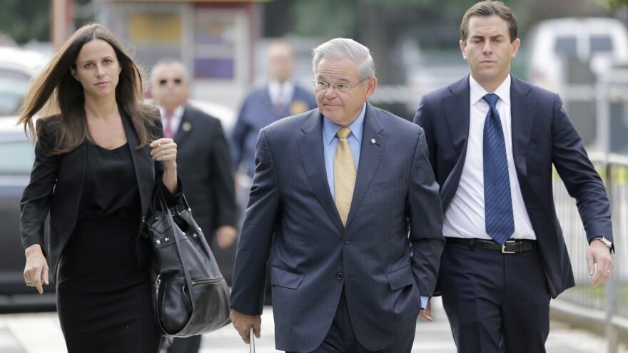 Sen. Bob Menendez (center) arrives with his children to court in Newark on Wednesday.