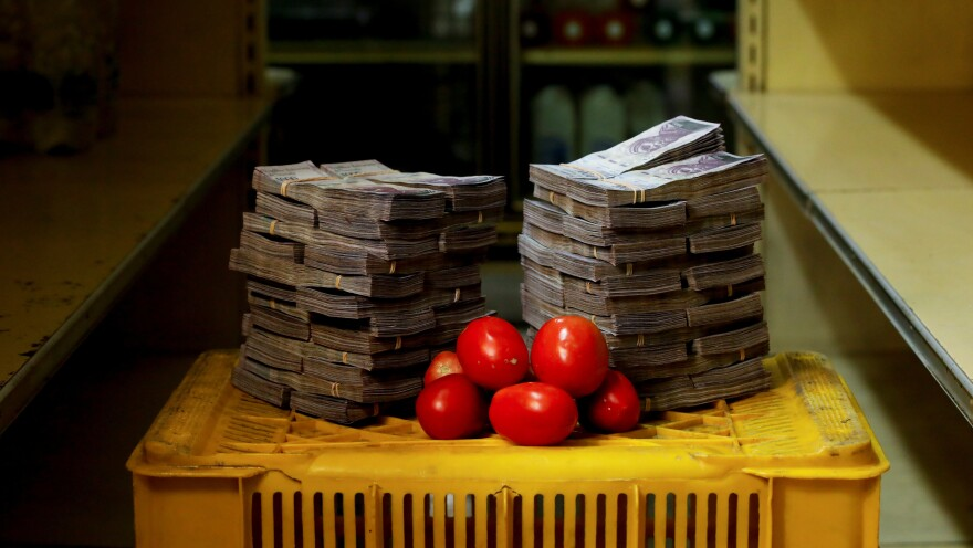 "A kilogram, or just over 2 pounds, of tomatoes sits next to the 5 million ""strong"" bolivars needed just to buy the bunch at an informal market in a low-income neighborhood of Venezuela's capital, Caracas."