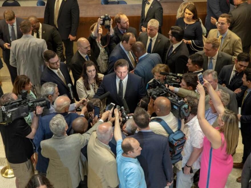 Gov. Ron DeSantis speaks with reporters after the 2019 legislative session comes to an end.