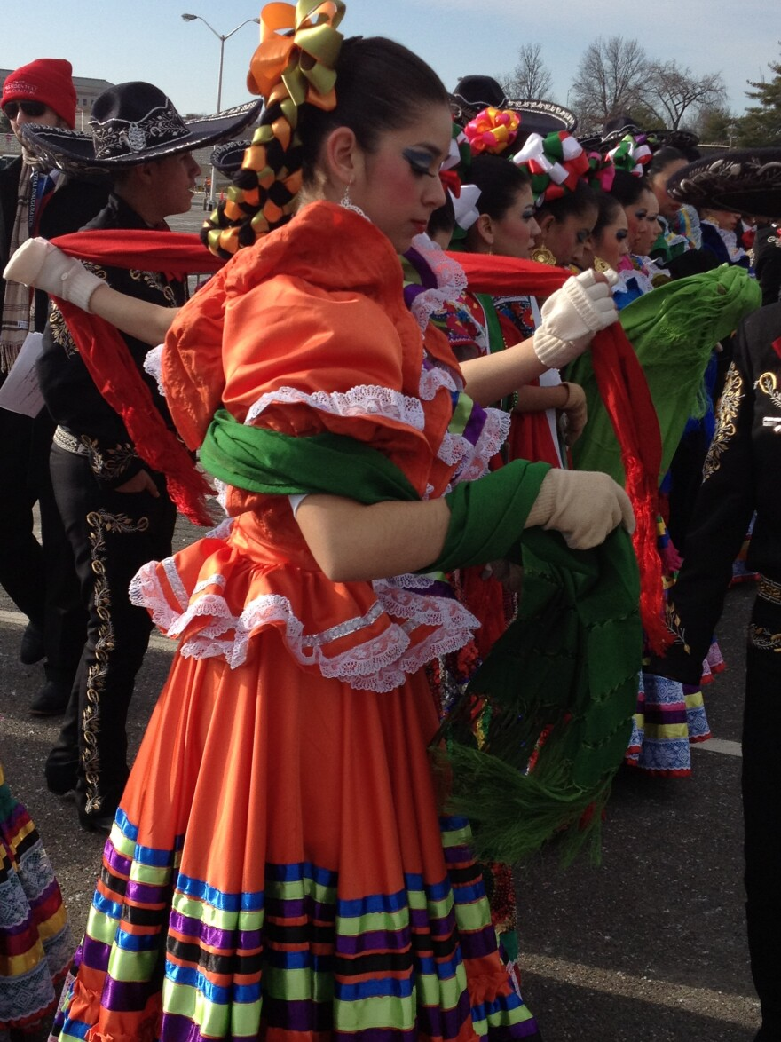 Members of Palmview High School's marching band and folklorico group, who traveled from La Joya, Texas, prepare for the inaugural parade in Washington, D.C.