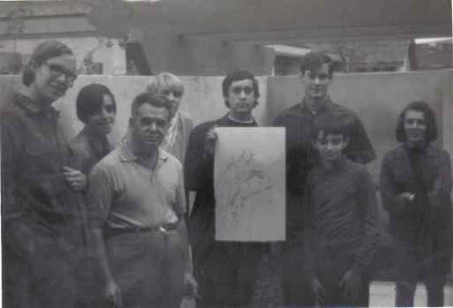 Convention committee members visit Jack Kirby (third from left) at his home in November 1969. Mike Towry is visible in the back, behind Kirby.