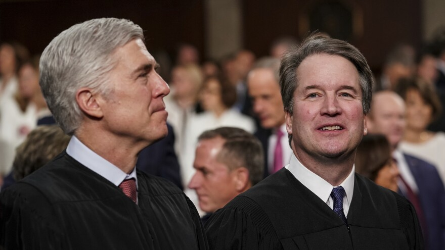 The two newest members of the Supreme Court, Associate Justices Neil Gorsuch, left, and Brett Kavanaugh watch as President Trump arrives to give his State of the Union address in February. Gorsuch and Kavanaugh clerked together for former Justice Anthony Kennedy, whose seat Kavanaugh now fills.