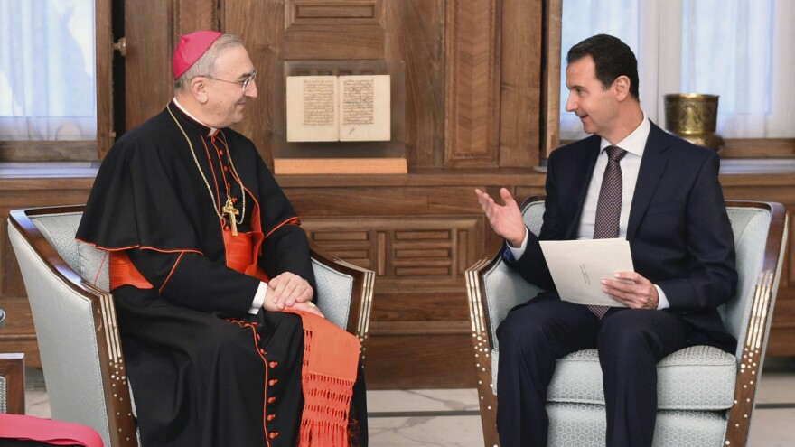 Syrian President Bashar Assad (right) speaks Monday in Damascus with Cardinal Mario Zenari, the head of the Catholic diplomatic mission in Syria. The photo was released by the Syrian official news agency SANA. The Syrian army has retaken almost all of the northern city of Aleppo, and Assad appears in a stronger position than at any point in the past several years.