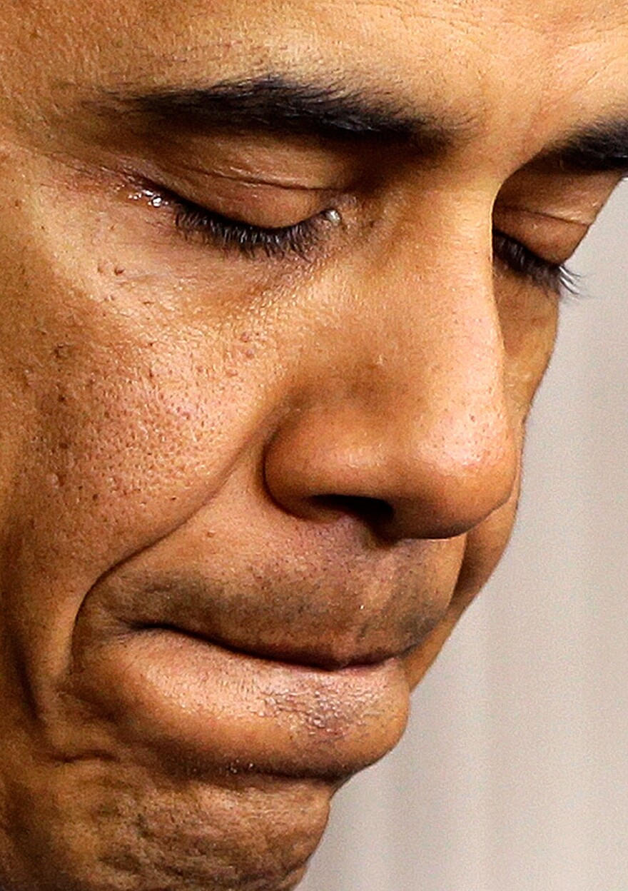 President Obama pauses as he speaks at the White House about Friday's school shooting in Newtown, Conn.