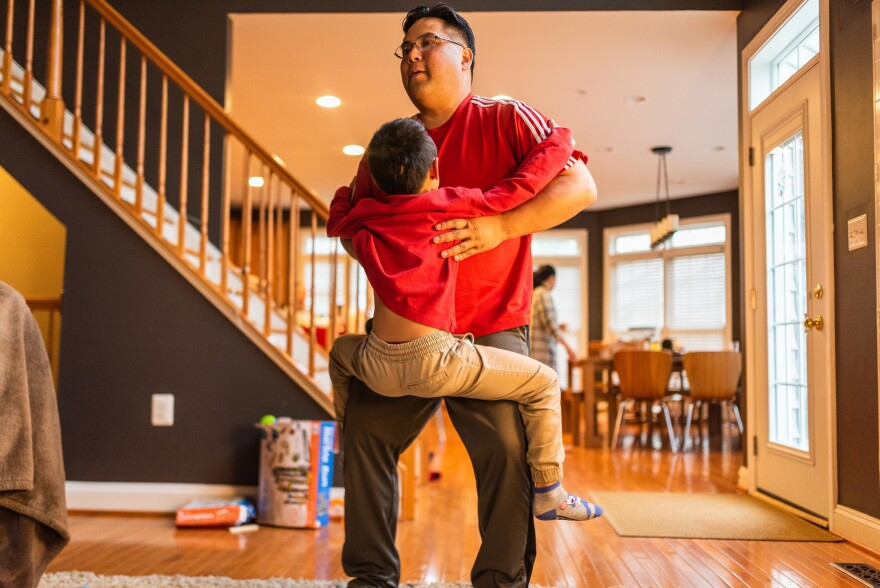 Hansel Pham lifts Henry at home on April 5, 2019.