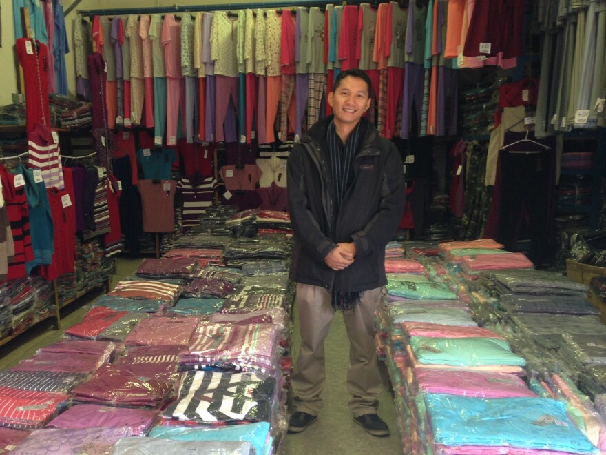"""Nguyen Kien Trung, 32, stands inside his family's clothing warehouse in Bratislava. """"It's a declining business, so we have to think out our future,"""" he says. """"I think I and other young Vietnamese have a good chance at finding work at a Slovak company. We speak the language. We know the culture."""""""