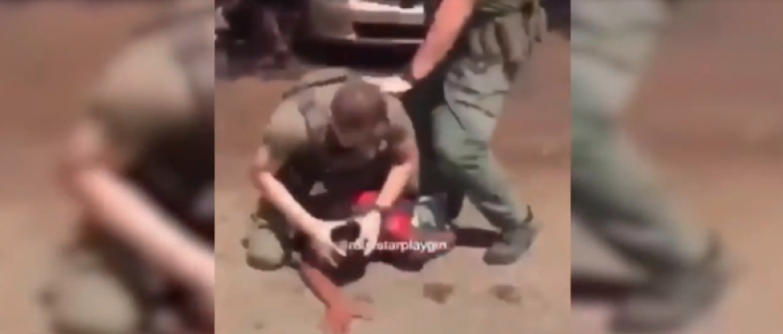 Screenshot cell phone video police arrest Delucca Rolle.png