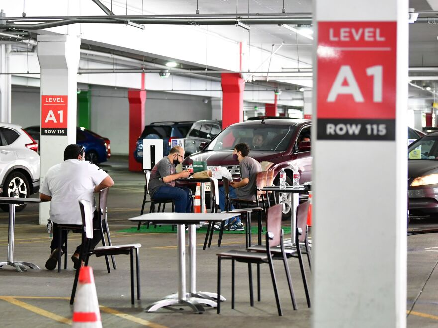 Customers enjoy an outdoor dining experience in the parking lot of the Glendale Galleria shopping mall on July 29 in Glendale, Calif., as the re-opening of businesses from the coronavirus pandemic spark creative ideas.