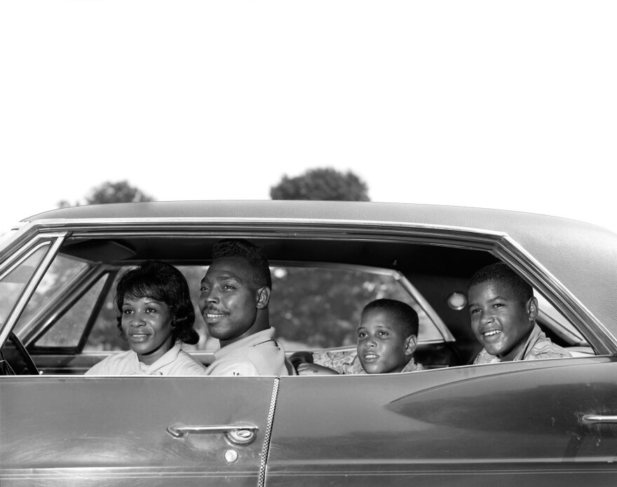 Side view of a family sitting in a four door sedan in the 1960s. (H. Armstrong Roberts/ClassicStock/Getty Images)