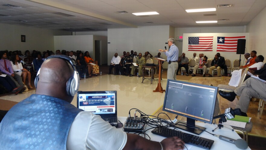 Craig Manning of the Centers for Disease Control and Prevention speaks with Liberian Americans in Atlanta about how the Ebola virus spreads.