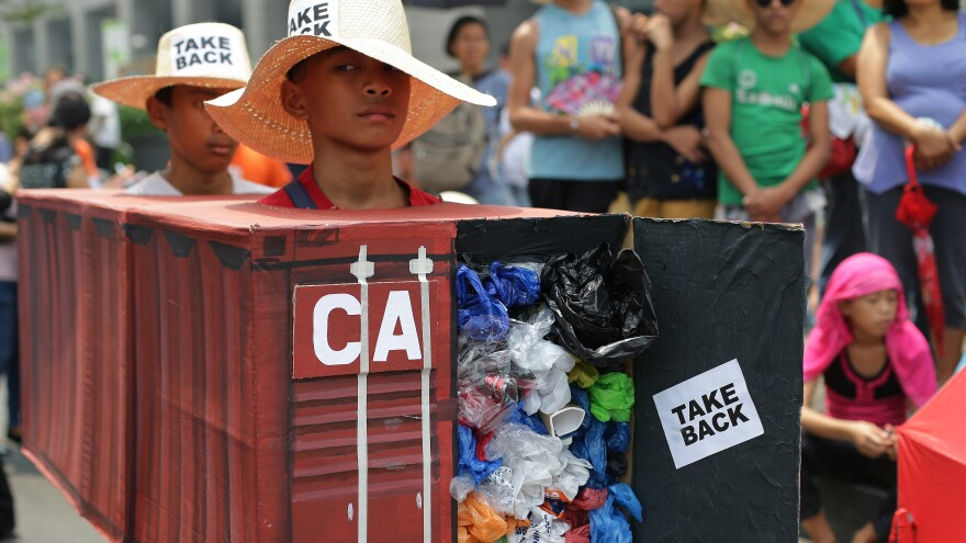 """I want a boat prepared"" to take tons of trash back to Canada, Philippines President Rodrigo Duterte said Tuesday. In this 2015 photo, Filipino activists wear shipping container costumes to call on Canada to remove the garbage from a port in Manila."