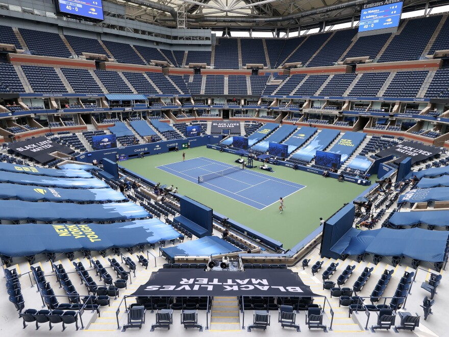 Karolina Pliskova of the Czech Republic and Anhelina Kalinina of Ukraine play their first-round match at a mostly empty Arthur Ashe Stadium on Monday. This year's U.S. Open is taking place without spectators because of the coronavirus pandemic.