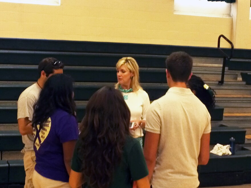 Counselor_Becky_Smith_talks_with_Cole_High_SChool_students_before_the_start_of_the_school_year_Aug_2013_0.JPG