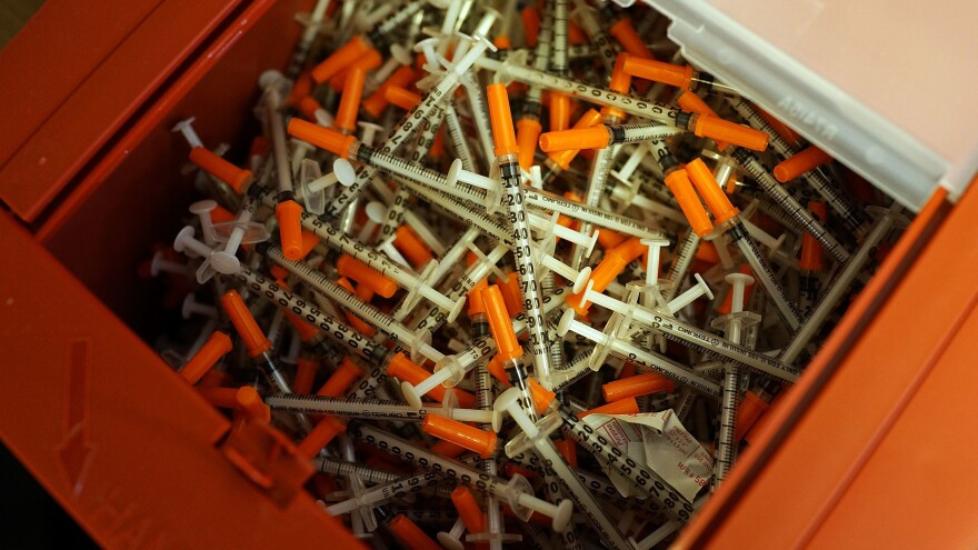 Used syringes rest in a pile at a needle exchange clinic in St. Johnsbury, Vt. The CDC says needle exchanges like this one, where users can obtain clean needles, help reduce the rates of death and transmission among those suffering from hepatitis C.
