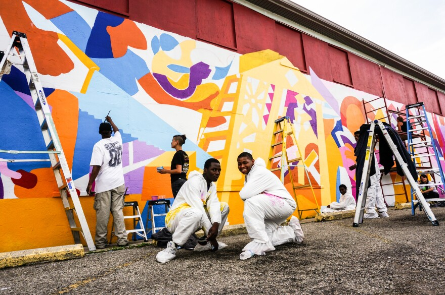 1._haalo_participants_work_on_a_1_500_square_foot_mural_at_the_wesley_community_center_in_westwood._haalo_stands_for_helping_adolescents_achieve_long-term_objectives_photo_jason_reynolds_wyso.jpg
