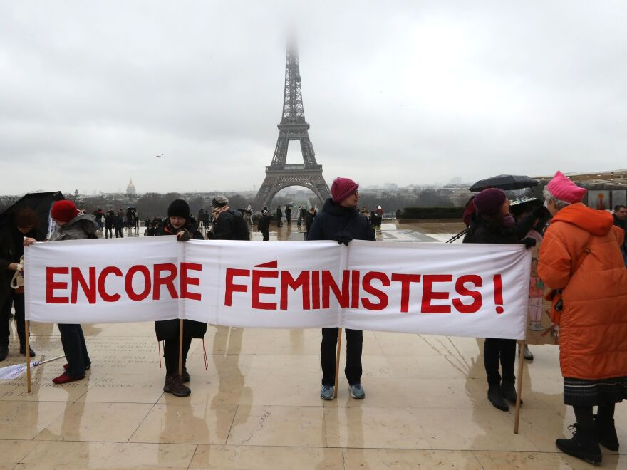 "Demonstrators hold a banner reading ""still feminist"" in front the Eiffel Tower during a women's march earlier this year in Paris."