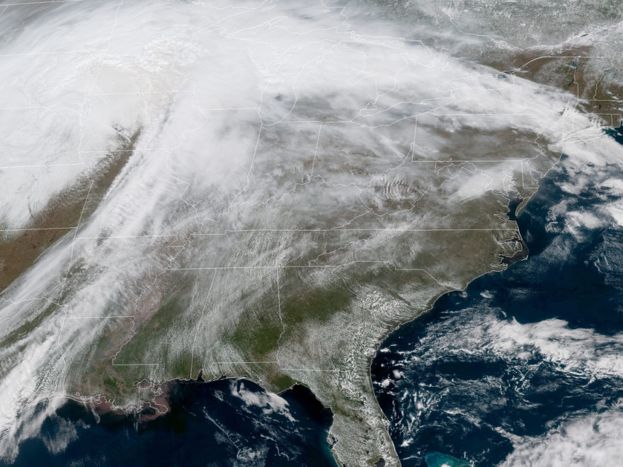 A massive spring storm is bringing blizzard conditions to several central U.S. states, leading officials to close hundreds of schools and hundreds of miles of roads.