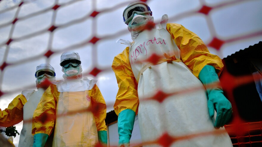 Health workers at the Doctors Without Borders facility in Kailahun wear protective clothing when treating Ebola patients.