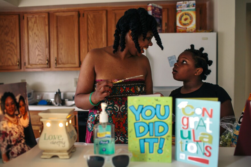 Jordan McClellan gets help making lunch from daughter Kyra Brooks in their apartment in Southeast Washington, D.C. McClellan has been fighting homelessness for most of her adult life, living in family shelters and transitional housing until she was moved into the rapid rehousing program.