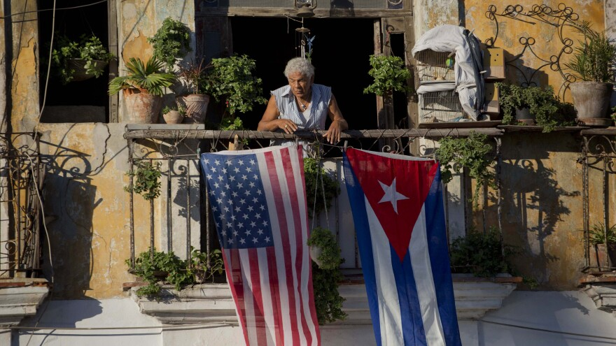 Javier Yanez decorated with U.S. and Cuban flags in Old Havana, Cuba, in 2014. President Trump is expected to reverse some of the easing in U.S.-Cuba relations that President Barack Obama initiated.