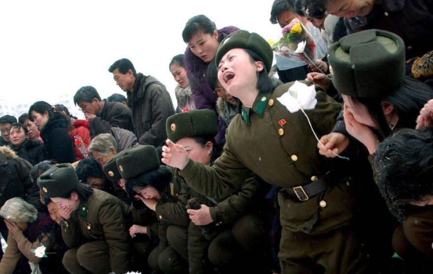 This handout picture taken by North Korea's official Korean Central News Agency on December 21 shows members of the Korean People's Army crying for late North Korean leader Kim Jong-Il in Pyongyang.