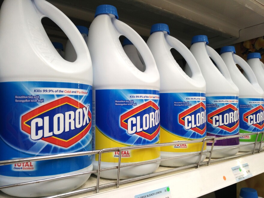 A row of bottles of Clorox bleach on a store shelf.