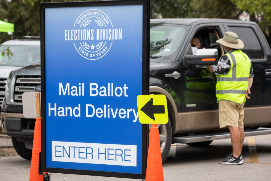 A voter pulls up to the drive-thru ballot drop-off location on Airport Boulevard.