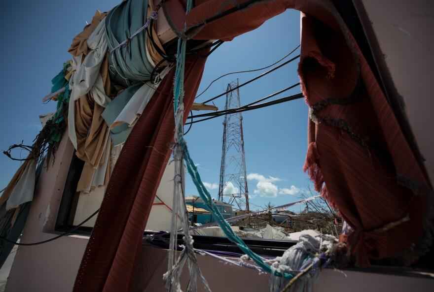 Debris frames a cell tower in Marsh Harbour. The official death toll in the Bahamas now stands at 50, and officials expect it to keep rising.