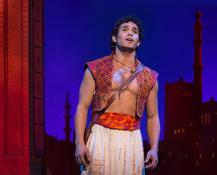 "Disney hit it big on Broadway with <em>The Lion King, </em>but <em>The Little Mermaid</em> and <em>Tarzan</em> didn't fare quite so well.<em> Aladdin --€"" </em>the Arabian Nights story of a young street urchin, a princess and a big blue genie — is Disney's latest adaptation attempt."