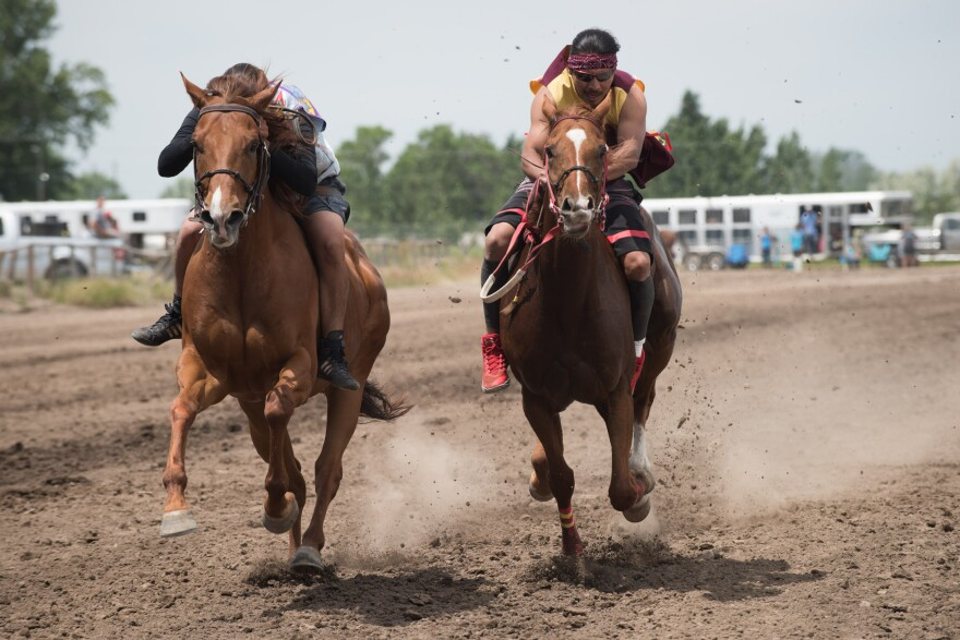 Photo of two riders and horses.