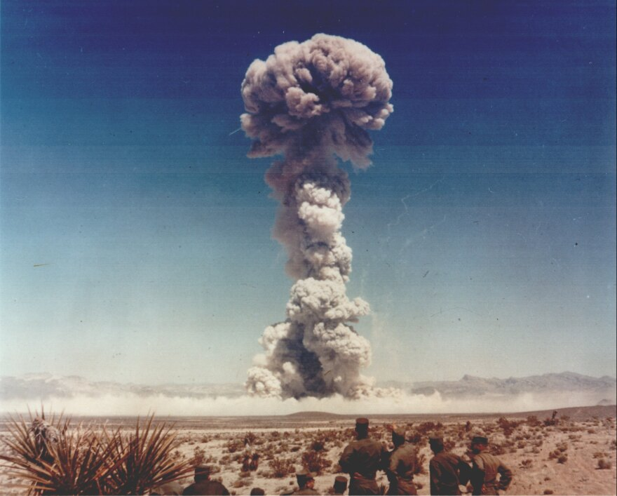 Observers watch a bomb go off at the Nevada Test Site during the Buster-Jangle series in the fall of 1951.