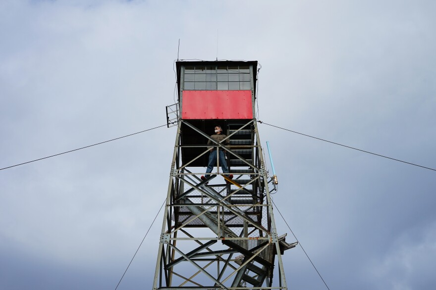 Connors stands in the lookout tower. In recent years, the number of active lookouts has dwindled from thousands to hundreds as technology has encroached.
