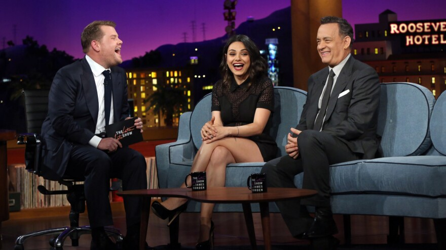 James Corden (left) talks to Mila Kunis and Tom Hanks on Monday's debut of <em>The Late Late Show with James Corden.</em>