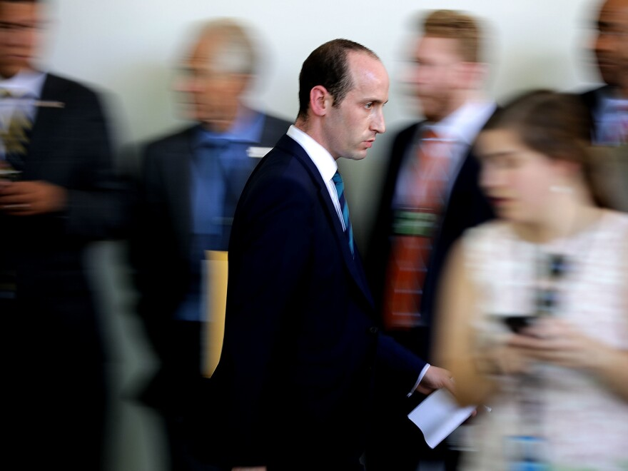 Miller moves quickly through the Rose Garden Colonnade while making last-minute preparations before President Trump announces his decision to pull the U.S. out of the Paris climate agreement in June.