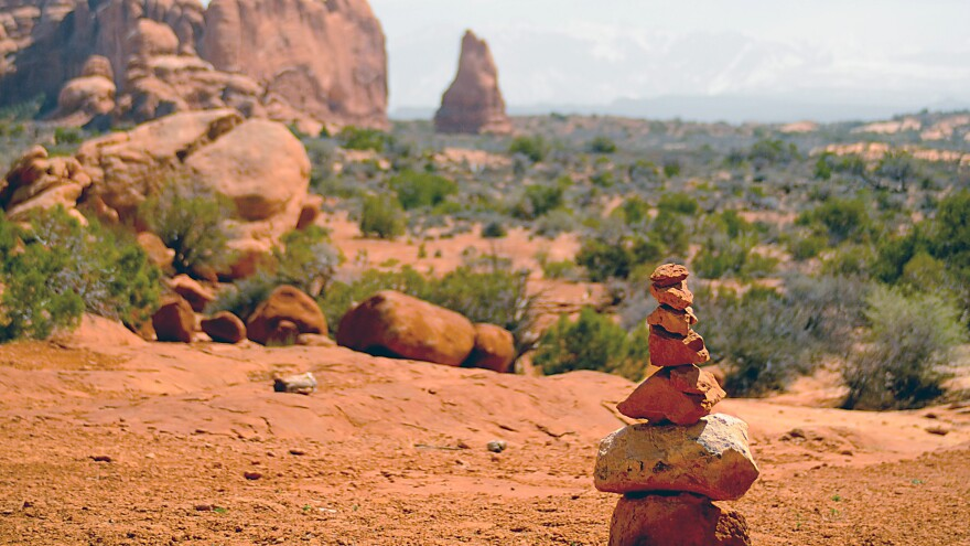 A cairn marks a trail in Arches National Park in Utah. Some people build the piles as a meditative exercise, but their proliferation has infuriated some other nature lovers.