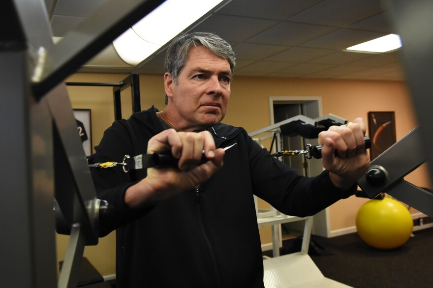 Tim works out at his home gym. Studies of ALS patients suggest people who do stretching and toning function much better. There's a concern if a patient does too much and tries to bulk up, he or she could tear the muscles.