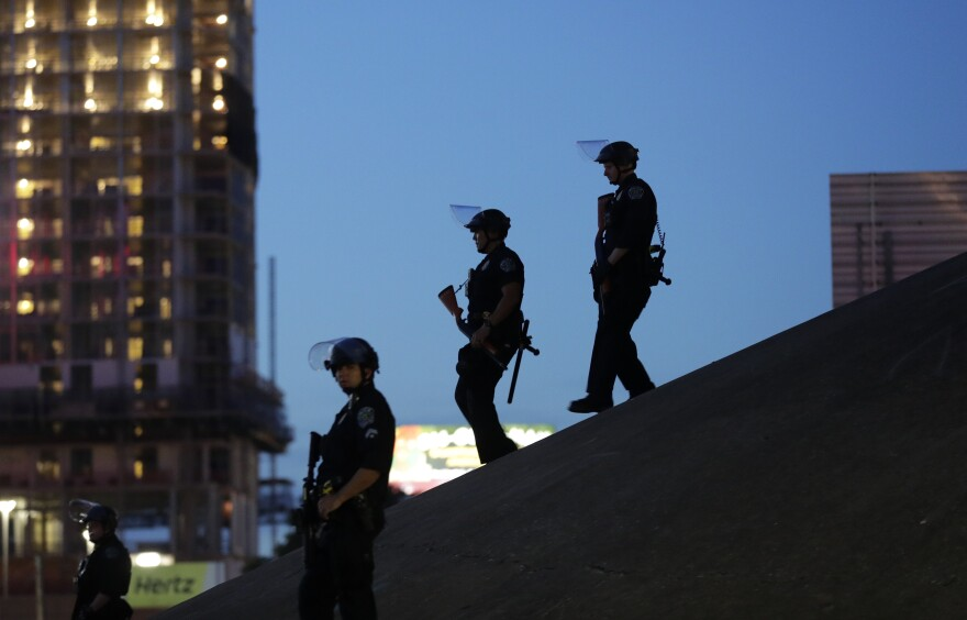 In this June 4, 2020, file photo Austin police keep watch as demonstrators gather in downtown Austin, Texas, to protest the death of George Floyd.