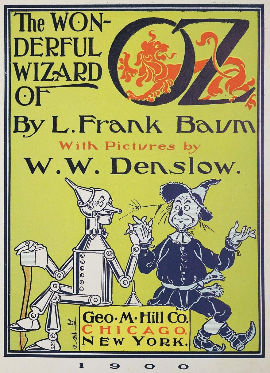 The illustrator W.W. Denslow was the first to draw Dorothy's now-iconic companions, pictured on the cover of the first edition of <em>The Wonderful Wizard of Oz</em>.