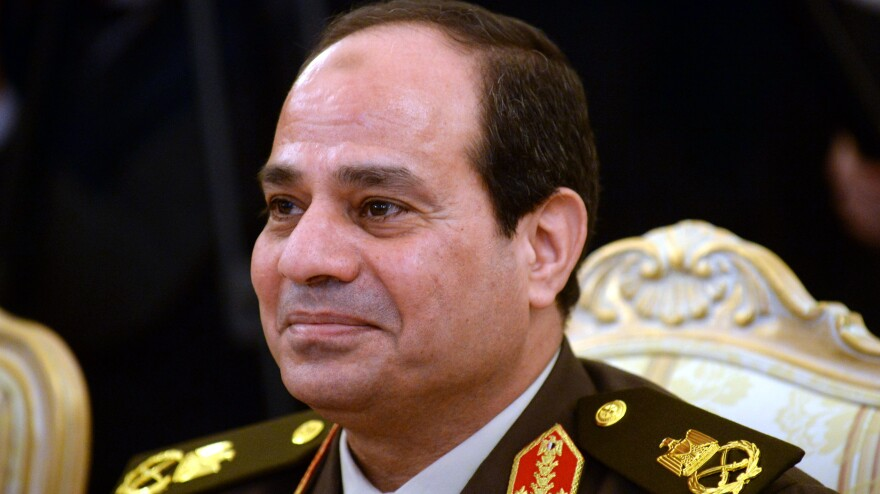 Egyptian army chief Abdel Fattah al-Sisi smiles during a visit to  Moscow, on Feb. 13. He is popular among many Egyptians and is considered likely to run for president.